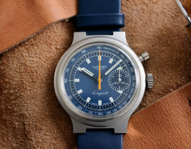 The orange second hand is striking on the dial.