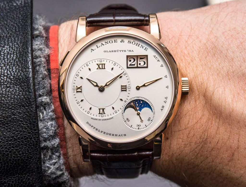 The 18k rose gold fake watch has silvery dial.